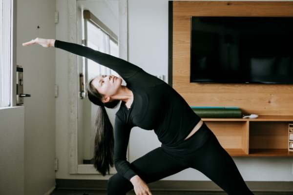 Girl doing yoga in guest room